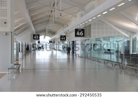 BIRMINGHAM, UK - APRIL 24, 2013: Travelers wait at Birmingham International Airport, UK. With 8.9 million travelers served it was the 7th busiest UK airport in 2012. - stock photo
