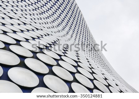 BIRMINGHAM, UK - DECEMBER 03: Low angle cropped shot of Selfridges building. The department store is part of the Bullring shopping centre complex. December 03, 2015 in Birmingham. - stock photo