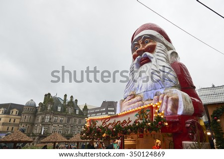 BIRMINGHAM, UK - DECEMBER 03: Low angle shot of large Santa Claus statue in Victoria Square. The statue was part of the decoration of the Christmas market. December 03, 2015 in Birmingham. - stock photo