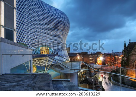 BIRMINGHAM, UK - JANUARY 30: Night scene in downtown Birmingham, UK on January 30, 2013 with the Selfridges Department Store overlooking the city' skyline. - stock photo