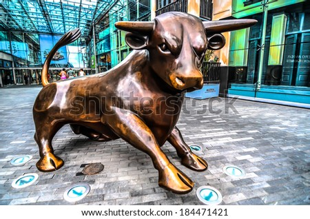 BIRMINGHAM, UK - 21 July 2013 : A Bull sculpture in front of Bullring Shopping Arcade, one of the landmark in Birmingham. This place attracts a lot of visitors from Birmingham itself and neighbors - stock photo
