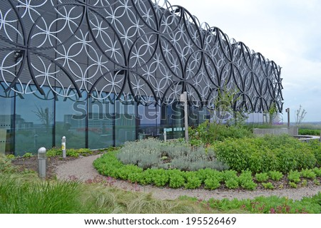 BIRMINGHAM, UK - May 27, 2014. A roof terrace garden and facade of the Library of Birmingham in the West Midlands, UK. The library is the largest in the UK.  - stock photo