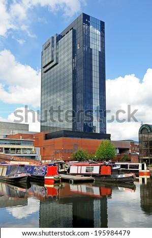 BIRMINGHAM, UK - MAY 14, 2014 - Narrowboats with the Hyatt Hotel to the rear, Gas Street Canal Basin, Birmingham, West Midlands, England, UK, Western Europe, May 14, 2014. - stock photo