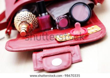birth control pill with condom - healthcare and medicine - stock photo