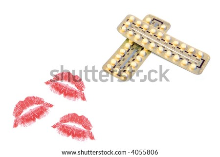 birth control pills and red colored lipstick kisses isolated on white background - stock photo