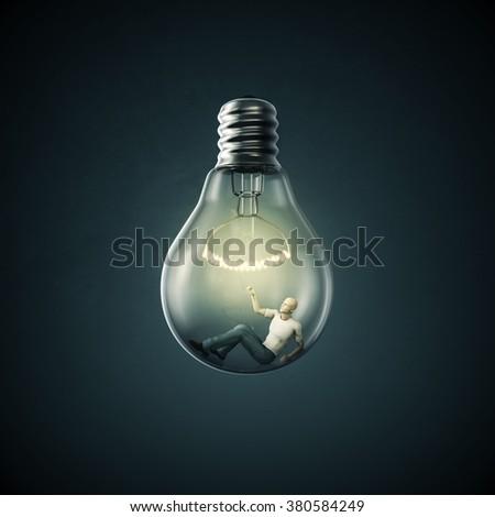 Birth of an idea / 3D render of man inside light bulb - stock photo