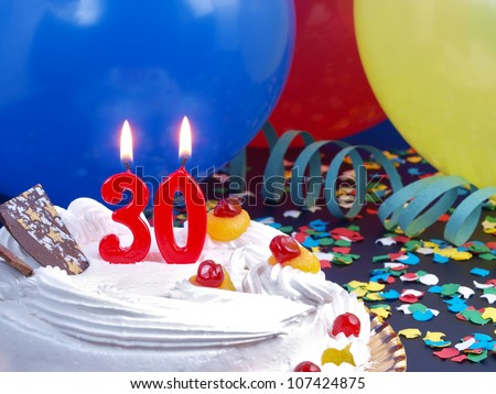 Birthday-anniversary cake with red candle showing Nr. 30 - stock photo