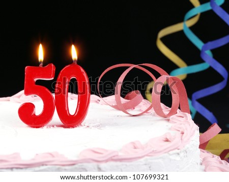 Birthday-anniversary cake with red candle showing Nr. 50 - stock photo