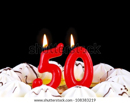 Birthday-anniversary cake with red candles showing Nr. 50 - stock photo