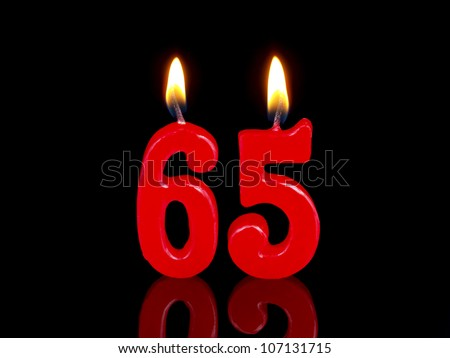 Birthday-anniversary candles showing Nr. 65 - stock photo