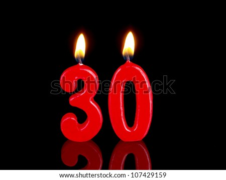 Birthday-anniversary candles showing Nr. 30 - stock photo