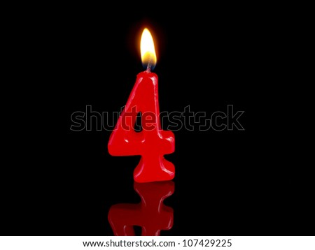 Birthday-anniversary candles showing Nr. 4 - stock photo
