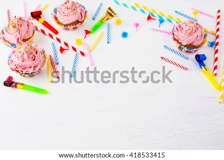Birthday background with pink cupcakes and candles. Birthday cupcakes. Gourmet cupcakes. Sweet dessert. Sweet pastry. Birthday invitation. Birthday mockup. Styled desktop. Birthday background. - stock photo