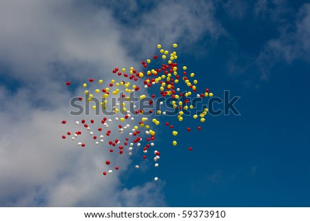 birthday balloons  in the blue sky - stock photo