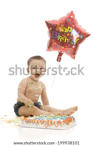 Birthday boy!  Adorable boy eating a birthday cake.  Isolated on white. - stock photo