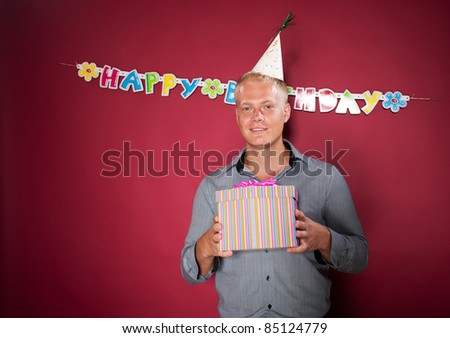 Birthday boy with gift at party - stock photo