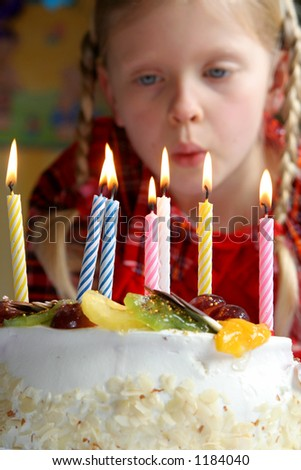 Birthday cake against a background of a little girl - stock photo