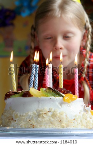 Birthday cake against a background of a young girl - stock photo