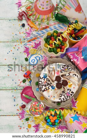 Birthday cake and various accessories for the holiday on a white background