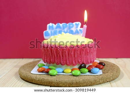 Birthday cake decorated with candles on red background