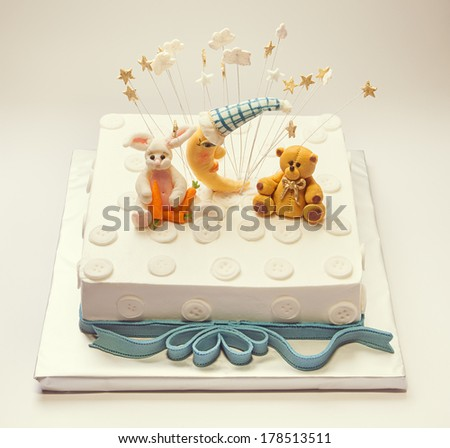 Birthday cake for a boy, funny decoration with buttons and animals made of sugar.