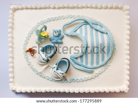 Birthday cake for baby, blue and white design, on light gray background.  - stock photo