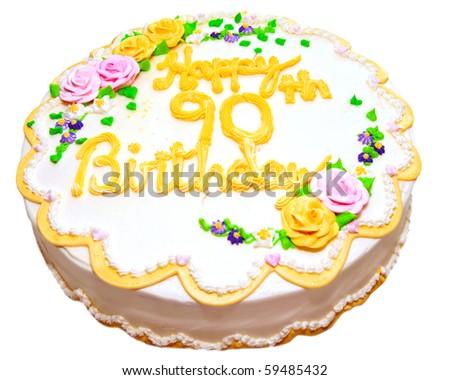 Birthday cake for senior citizen, isolated on white. - stock photo