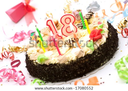 birthday cake for 18 years jubilee surrounded by streamers and gift boxes on white background - stock photo
