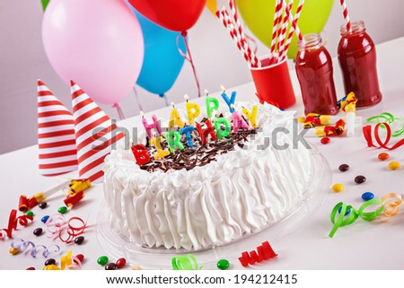 Birthday Cake On Colorful Balloon Background With Other Birthday Decoration. Focus is on cake. - stock photo