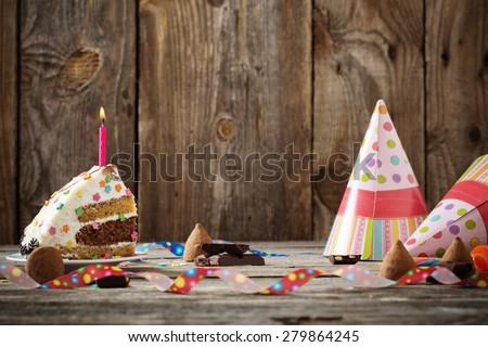 Birthday cake on wooden background - stock photo