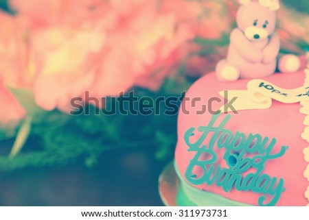 birthday cake with bears and flowers - stock photo