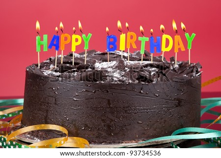 Birthday Cake with birthday candles isolated on red - stock photo
