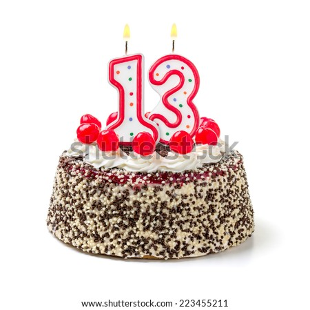 Birthday cake with burning candle number 13 - stock photo