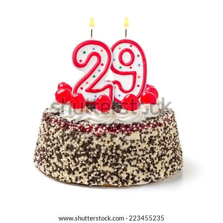 Birthday cake with burning candle number 29 - stock photo