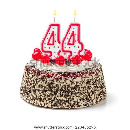 Birthday cake with burning candle number 44 - stock photo