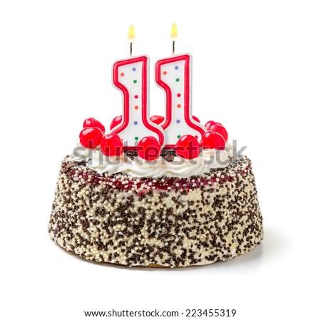 Birthday cake with burning candle number 11 - stock photo