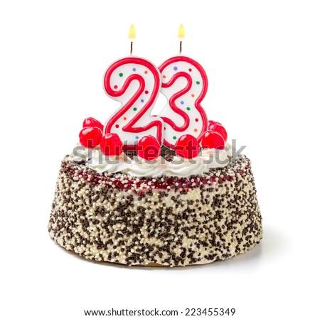Birthday cake with burning candle number 23 - stock photo