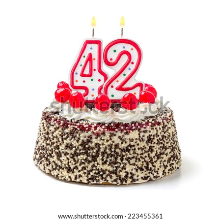 Birthday cake with burning candle number 42 - stock photo