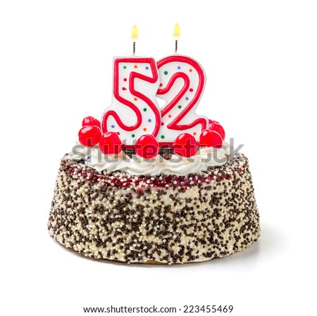 Birthday cake with burning candle number 52 - stock photo