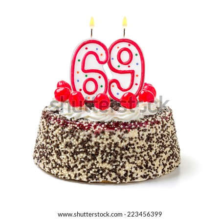 Birthday cake with burning candle number 69 - stock photo