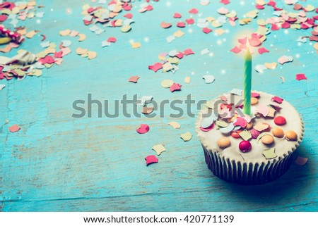 Birthday cake with candle  and confetti on  Turquoise blue shabby chic wooden background. Birthday festive greeting card - stock photo