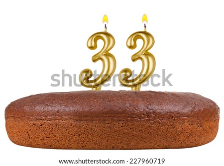 birthday cake with candles number 33 isolated on white background - stock photo