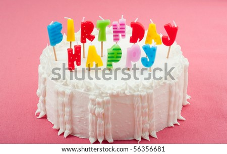 Birthday Cake with Candles on Pink - stock photo