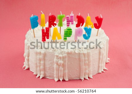 Birthday Cake With Candles on Pink Background - stock photo