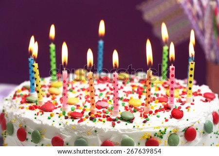 Birthday Cake Candles On Purple Background Stock Photo Safe to Use