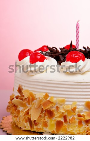 Birthday cake with cherries - stock photo