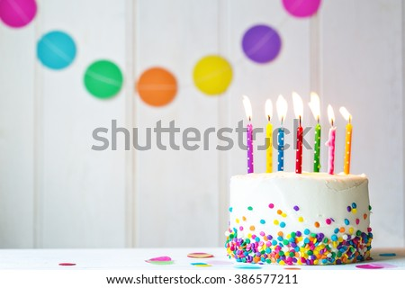 Birthday cake with colorful candles - stock photo