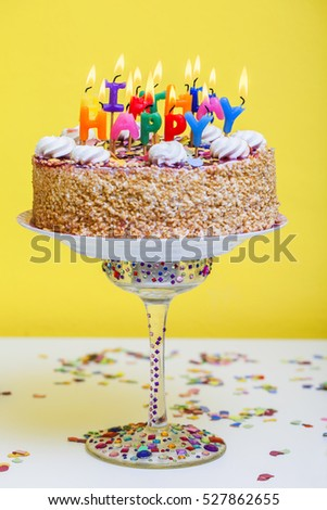 Birthday cake with colorful happy birthday candles