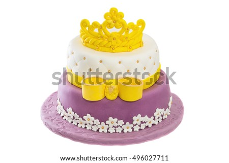 Birthday cake with crown and bow.
