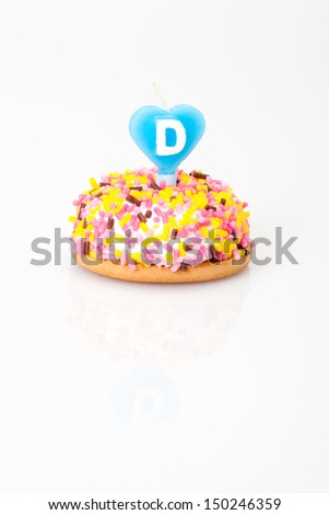 birthday cake with heart shaped candle (with letter D) - stock photo